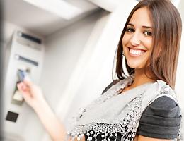 Girl using ATM
